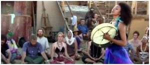 a group of people lying in a room forming a circle and a healing crystals in the middle